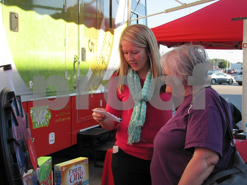 Amber Kastler, HyVee dietician, explains some nutrition facts with attendees.
