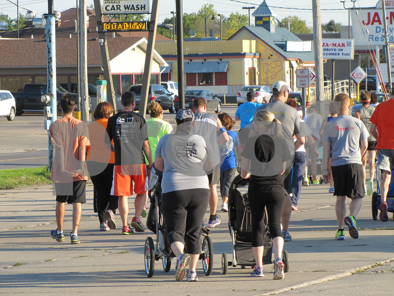 The group takes off toward 5th Ave. So. to head east to the walking trail on No. 31st St.