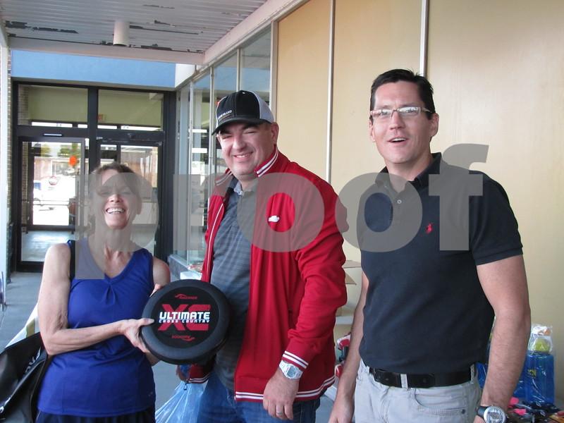 Deb Larson, with Saucony shoe representative Jeff Hanes, and Craig Jarrard, owner of Brown Shoe Fit Co.