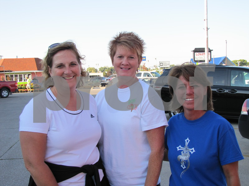 Mel Patterson, Karen Little, and Carrie Kee before they set out on the walk/run from the parking lot of Brown Shoe Fit Co. and HyVee Drugstore.