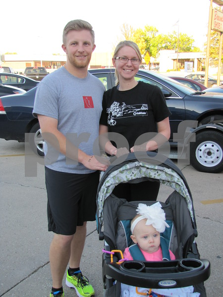 The family of Jacob and Mallory Asche and Haddie in stroller are ready for an evening of fitness.