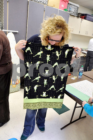 -Messenger photo by Joe Sutter<br /> <br /> Volunteer Heather Nicholls shows what the finished pillowcases look like that are sent to area hospitals.