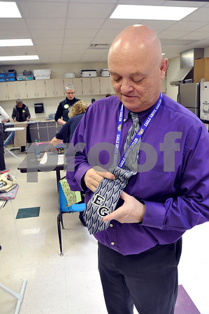 "-Messenger photo by Joe Sutter<br /> <br /> Middle School Principal Scott Jeske shows the customized tie made for him by Aaron Eilerts on his first day as principal. Jeske had never even had Eilerts as a student. ""He wanted to make my first day better,"" Jeske said."