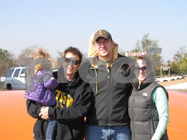 Nadine Schlienz holding Sophia Schlienz, Craig and Jamie Schlienz.