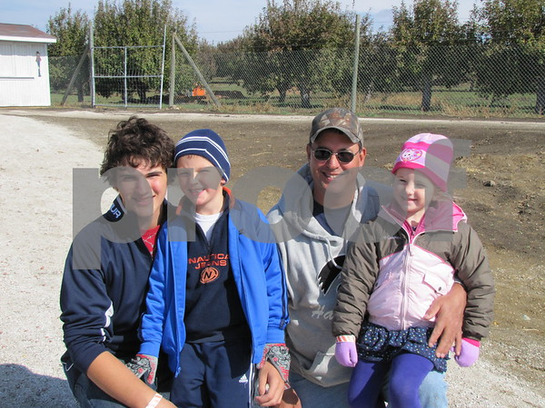 Ty, Broc, Mark, and Brandi Patzner enjoyed an afternoon at Applefest at the Community Orchard north of Fort Dodge.