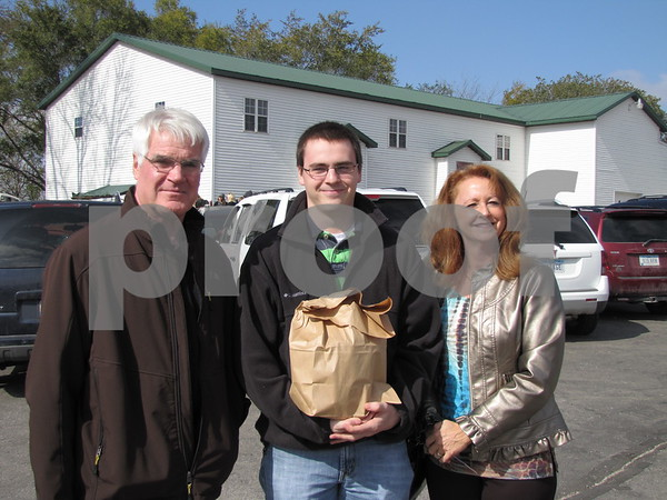 Britt, Weston, and Pam Shelton at the Community Orchard.
