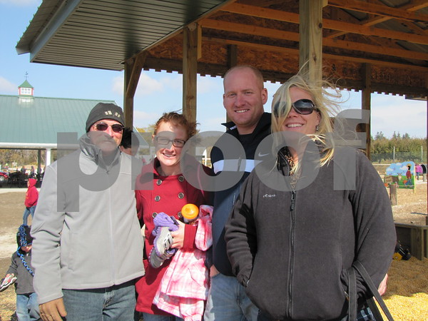 Tom Sigler, Jenna Michaels, and John and Amanda Sigler enjoyed an afternoon with family at the 'Back 40 Playground' at the Community Orchard's Applefest.