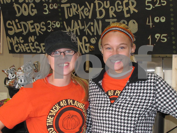 Bailey Lowrey and Baylie Stephan are all smiles and ready to serve you at 'Back 40 Playground' snack shop.