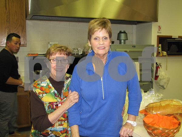 Karen DeWinter and Jo Shelly work behind the scenes in the kitchen at First Congregational Church UCC.