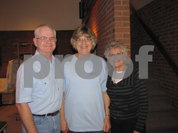 John and Karen Eveland posed with greeter Betty Donahoe.