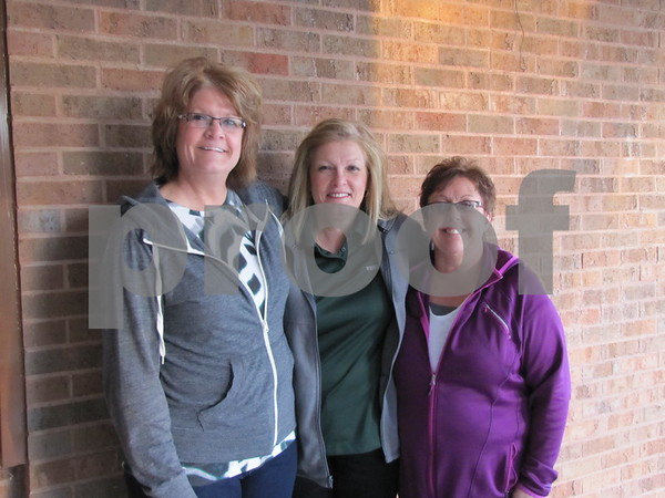 Jill Mischke, Jan Messerly, and Annette Warner head into the soup supper at First Congregational Church.
