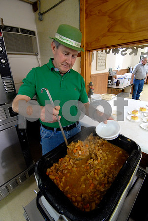 -Messenger photo by Hans Madsen<br /> <br /> Ned Munn, of Emmetsburg, dishes up a bowl of his famous Irish stew Saturday afternoon at the Senior Center in Emmetsburg. Munn has been making the stew for the annual Palo Alto County Democratic Party fundraiser since 2000.