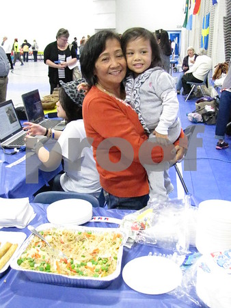 Ida Burleson and Lana Garland in the Philippines' booth.