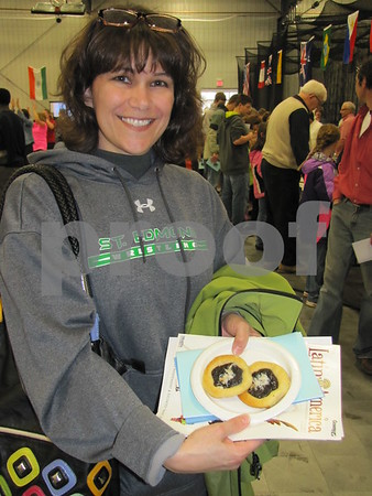 Teresa Noughton shows some homemade Czech kolaches she received at the Festival of Nations.  She highly recommended them!