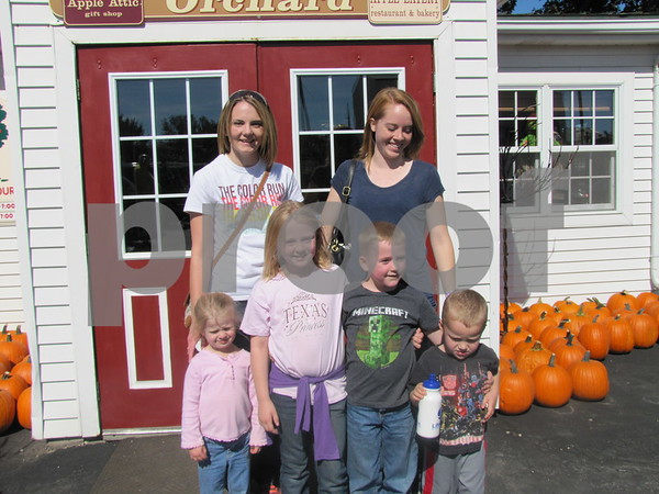 Robin Pearce and Rachel Stevens of Mason City brought the kids to Apple Fest at the Orchard.