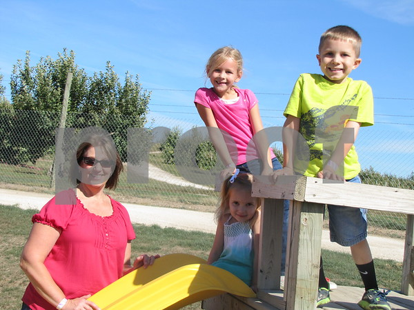 Madison and Ethan Henrichs, and Olivia Halverson had fun with grandma Joni Halverson at Apple Fest in 'The Back Forty'.