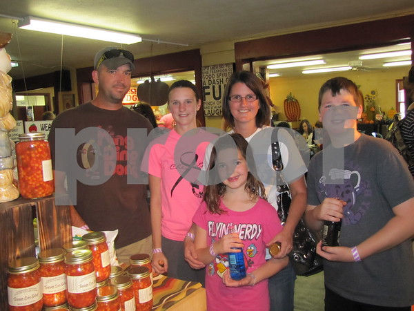Jon, Hailee, Leslie, Grace, and Christian Brundrett shop at the Orchard during Apple Fest.