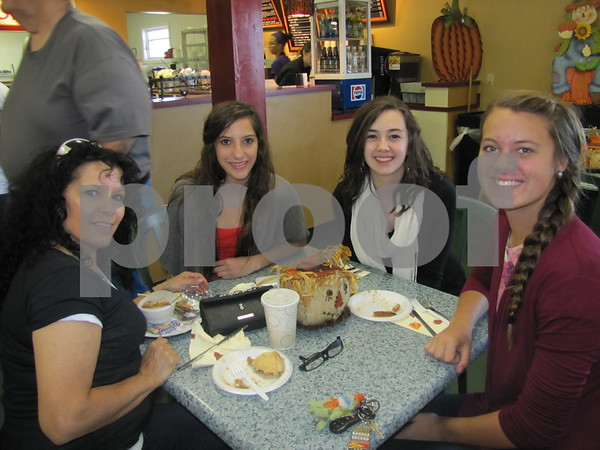 Berta Alberts, Mekenzie Alberts, Lydia Schroeder, and Samantha Nerem enjoy lunch at the Orchard during Apple Fest.