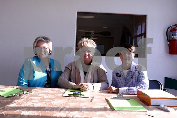 Linda Benson, Jo Lellen Hunter, and Nancy Macke running the sign and drive at Macke Motors.