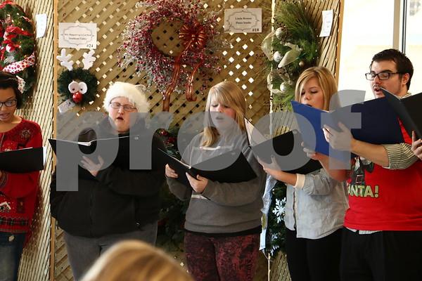 Victoria Vote, Jordan Hartig, Patricia Snyder, Megan Snyder, and Mr. Lewis singing for Macke Motors.