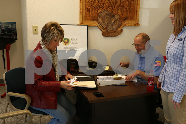 Marcie Boerner and Rick Breeden totaling up ticket and raffle sales.