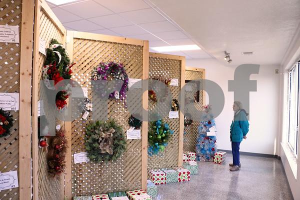 Darlene Nyren looking over the wreaths.