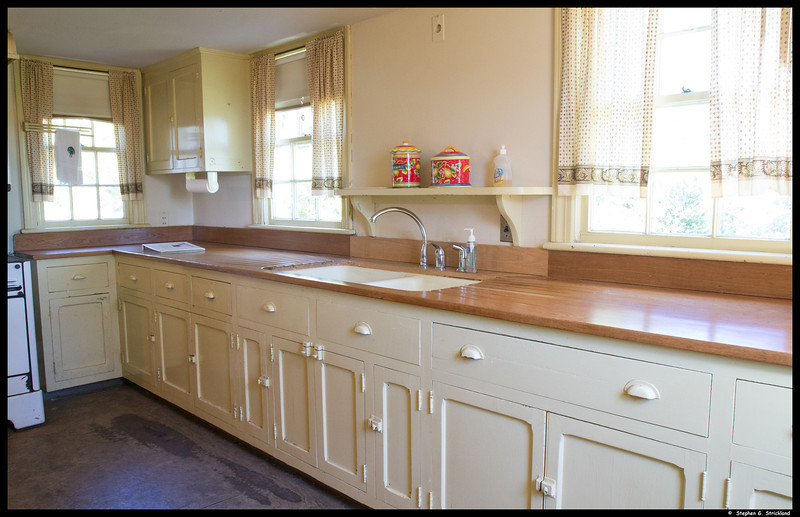 Kitchen With Oak Countertops and Backsplashes.