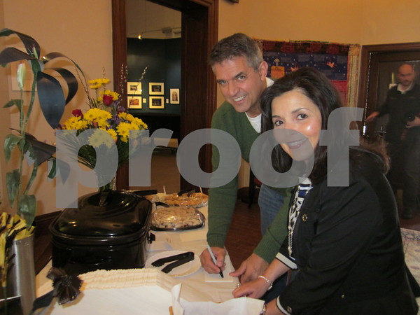 Don Woodruff and Deb Johnson help with the Danish food that was served.