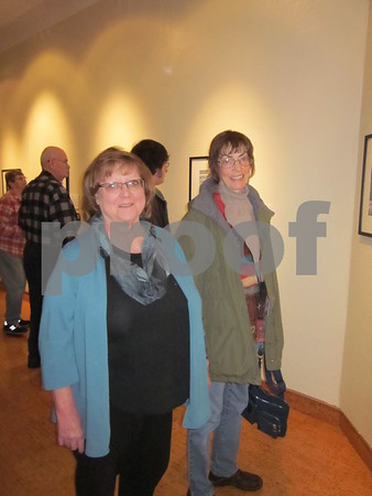 Maureen Powers and Linda Flaherty attend the opening reception for Hans Madsen at the Blanden.