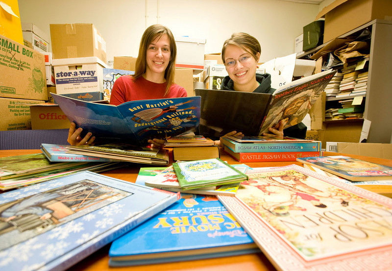 Katie Clark and Jessica Carr helped sort books to be sent to Belize.