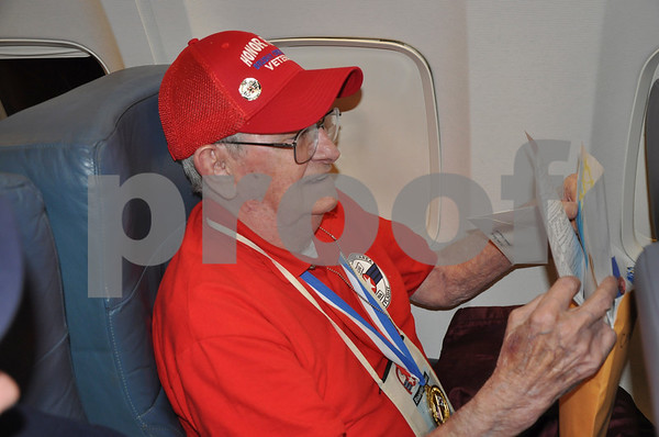 - Messenger photo by Peter Kaspari<br /> <br /> Charles Rees, of Vincent, opens his mail on the flight back to Fort Dodge Saturday night. Rees received 29 letters from friends and family members.