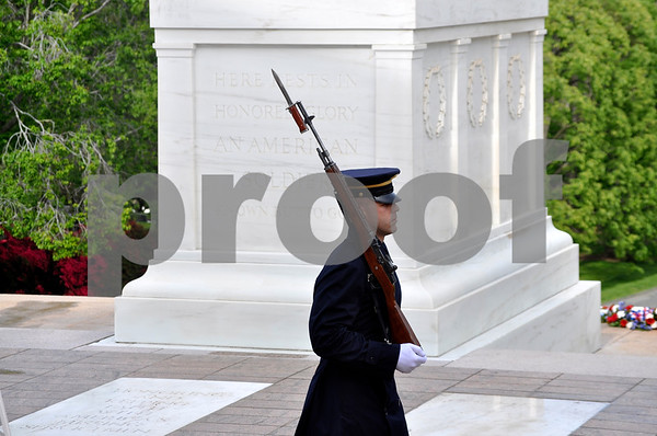 - Messenger photo by Peter Kaspari<br /> <br /> An Army member guards the Tomb of the Unknown Soldier at Arlington National Cemetery.
