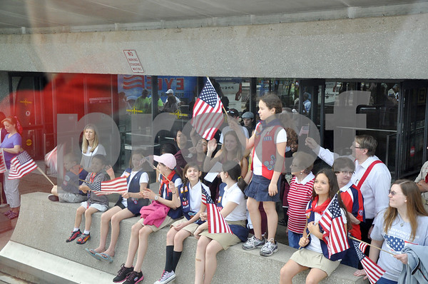 - Messenger photo by Peter Kaspari<br /> <br /> A group of Girl Scouts waves their flags at all the veterans on the Brushy Creek Area Honor Flight as they prepare to depart for Washington, D.C. from Dulles Airpot.