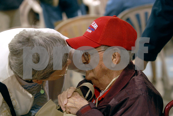 -Messenger photo by Hans Madsen<br /> <br /> Charles Rees, of Vincent, is all smiles after getting a kiss from his wife Janice Saturday morning as he gets ready to depart on the Brushy Creek Area Honor Flight to Washington D.C. Rees served in the Navy.