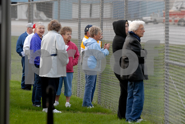 -Messenger photos by Hans Madsen<br /> <br /> Family, spouses and well wishers watch through the fence as the Brushy Creek Area Honor Flight prepares to take off from the Fort Dodge Regional Airport Saturday morning.