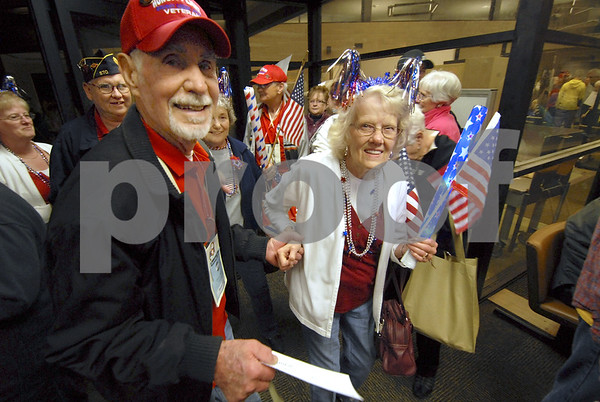 -Messenger photo by Hans Madsen<br /> <br /> Tom Brown, of Fort Dodge, is welcomed home by his girlfriend, Doris Grell, of Fort Dodge, at the Fort Dodge Regional Airport Saturday night after taking the Brushy Creek Area Honor Fligh to Washington, D.C.
