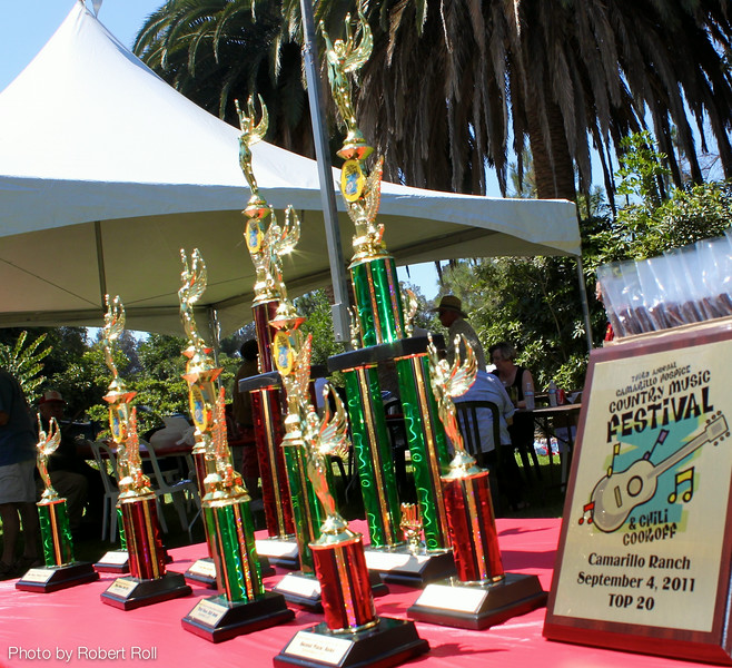 Trophies were awarded at the judging of the International Chili Society sanctioned event.<br /> Top honors for Best Red Chili: xxx<br /> Best Chili Verde: xxx<br /> People's Choice: xxx