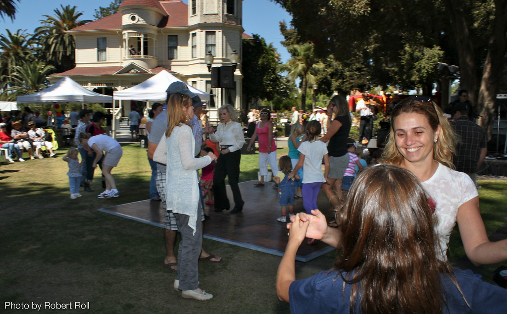 Country music lovers of all ages dance to the crowd-pleasing tunes of the Tim Buley Band.  The 3rd Annual Camarillo Country Music Festival and Chili Cookoff held on September fourth this year helped raise more than $60,000 for the event's sponsor, the non-profit Camarillo Hospice.