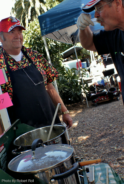 Ken Hook of Corona California's On the Road Chili awaits the critical judgement of fellow chef Clark McGee as they season a pot of their  Tri-tip Chili for the third annual Camarillo Country Music Festival and Chili Cookoff.