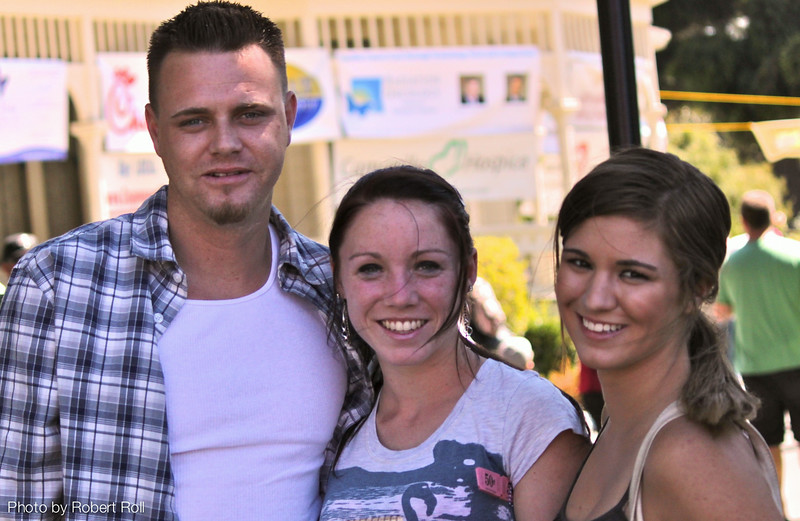 Jonathan Layle of Oxnard accompanies Camarillo residents Alexis Valenzano and Sunni Chapman for a day of cool country tunes and red hot chili at the third annual Camarillo Country Music Festival and Chili Cookoff on Sunday, September 4.<br /> More than 2,100 attended the fundraiser to sample artisanal chili, view classic cars and dance to the music of The Tim Buley Band and Caught Red Handed.
