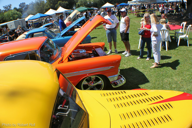 Three generations of automotive history were represented at the third annual Camarillo Country Music Festival and Chili Cookoff.  Ranging back from Willie Bidwell's yellow and red 1937 Ford coupe is an orange 1956 Chevy Nomad wagon, a 1965 Chevrolet El Camino, Susan Carter's 1946 Chevrolet Fleetmaster convertible and a blue and white racing striped Carroll Shelby Mustang.