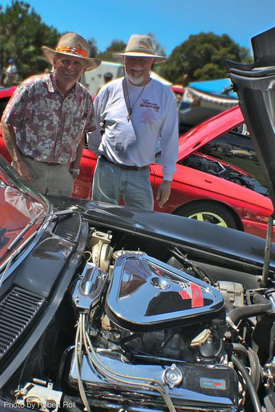 Pat Carse (left) and John Drake of Newbury Park inspect the spotless engine block of Drake's 1966 Chevrolet Corvette.