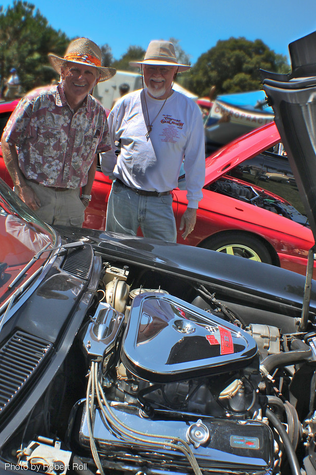 Pat Carse (left) and John Drake of Newbury Park inspect the spotless engine block of Drake's 1966 Chevrolet Corvette.