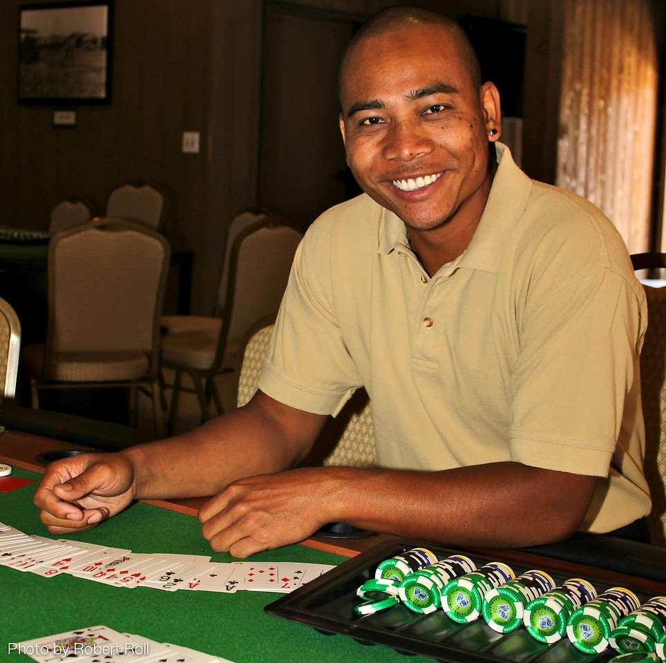 Chneuth Ham holds all the cards at Table Two of the Texas Hold 'em Tournament.