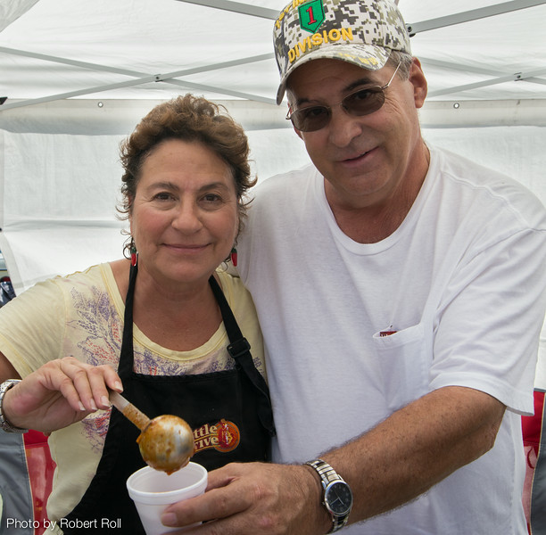 Chili chef Ray Bogart takes a curtain call with his wife Mary as their special recipe begins to create a buzz at the 2014 Camarillo Chili Cook-Off and Music Festival held at Adolfo Camarillo Ranch.