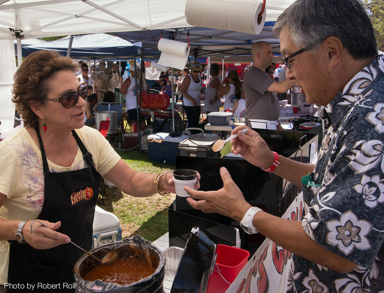 Mary Bogart of Boulder City, Nevada serves up a helping of her husband's namesake Red Chili at the sixth annual Camarillo Chili Cook-Off and Music Festival.