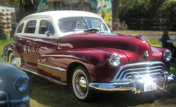 """Chili chef Steve """"Ughlee"""" Austin captured the stately power of this two-tone Oldsmobile Series 60 four-door sedan."""