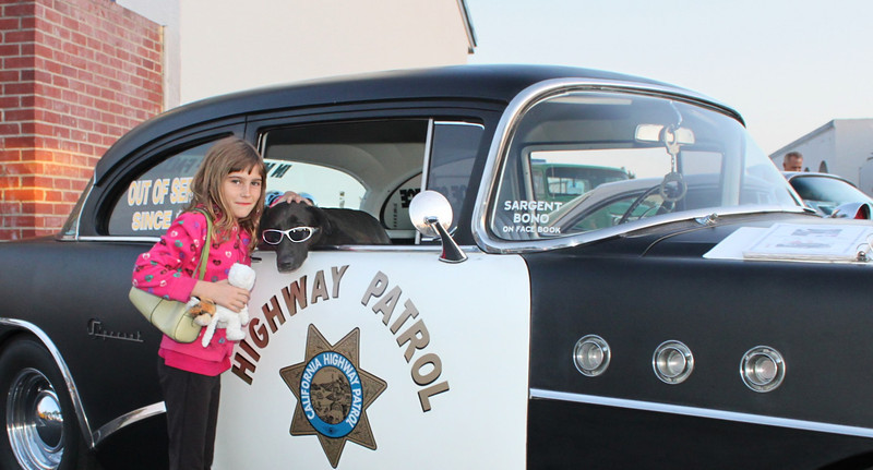 Cruise Night veteran Sargent Bono presents a pettable profile to Paige, an animal-loving third-grader from Serra School in Ventura.