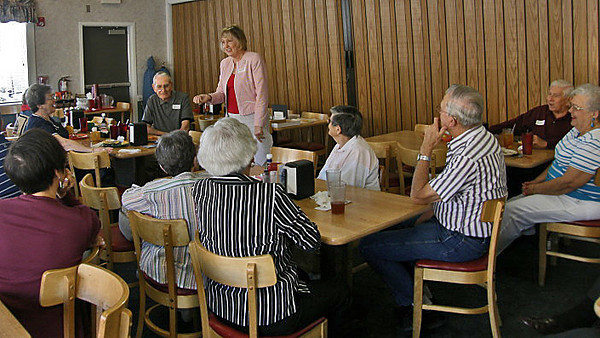 President Janie Park visits with the group attending the January 2011 gathering at the Sun City (AZ) Country Club & Golf Course.