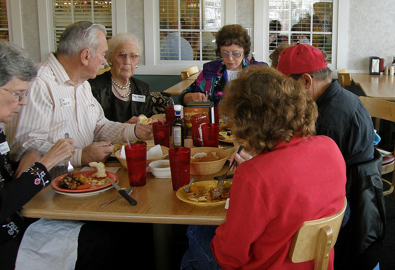 I believe these would be (from left-to-right) the Roberts group:  Barb and Bob Roberts of Mesa, AZ; and honoree Evelyn Roberts.  At the center-top of the photo is Lois Christensen's daughter, Jerrie Roberts (don't know, but I don't believe she's related to the Roberts group at left, is she?)  Help!  The folks with their backs to the camera in this view would be the Christensens.